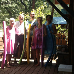 The latest fashion available at the hot springs... tie dye with matching noodles. Check out Papa Art's socks.