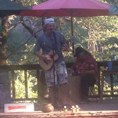 Pilot Hayes, an amazing and energetic guitar player, with Tony Alhino doing backup on box, at the Labor Day barbecue